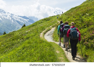 Group of hikers follow a trail in the French Alps above Chamonix.