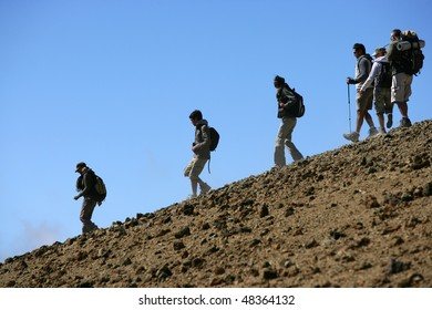 Group of hikers going down a hill