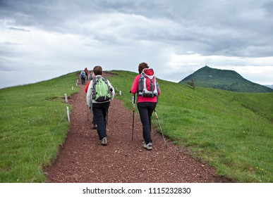 group of hikers going to the top of the mountain