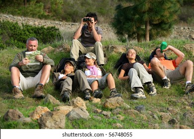 Group of hikers laid in the grass