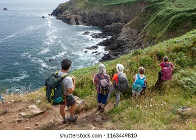 group of hikers looking at the ocean