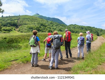 group of hikers looking at the summit