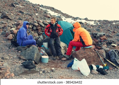 Group of hikers in the mountain. climbers in the camp near the tent. mountaineering