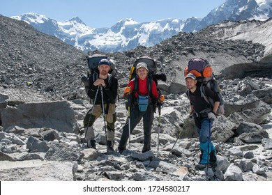 A group of hikers on the background of Belukha Mountain (4,506 m, 14,784 ft.), the highest peak of the Altai Mountain. Katun range, Altai, Altai Republic, Siberia, Russia.