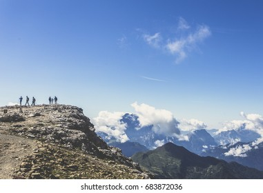 Group of hikers on top of the  mountain. Enjoying in Dolomites region mountains in summer season.