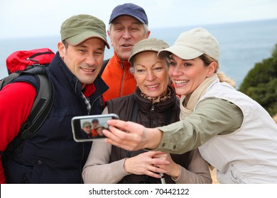 Group of hikers taking picture of themselves