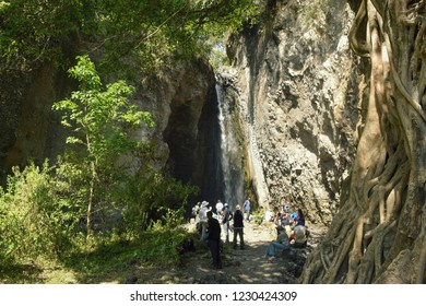 A group of hikers at Tululusia waterfall in Arusha, Tanzania. I took the photo on October 21st, 2015 at Arusha National Park, Tanzania