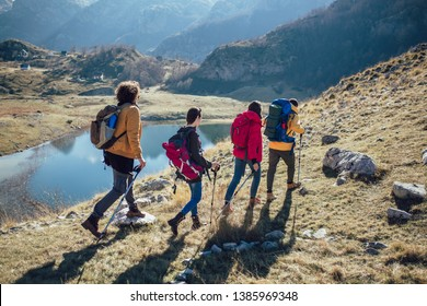 Group of hikers walking on a mountain at autumn day