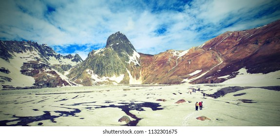 Group of Hiking with backpack on snow mountains