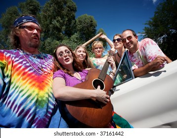 Group of hippies with female guitar player