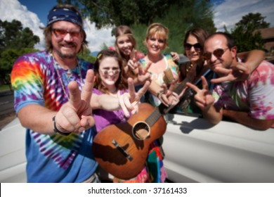 Group of hippies making peace signs