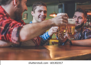 Group Of Hipster Friends Drinking Craft Beer focus on Hipster