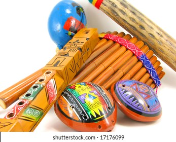 A group of Hispanic musical instruments with white background.