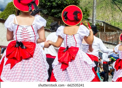 Group Of Hispanic People From Ecuador Is Dancing On The Streets Of Banos De Agua Santa, South America, Christmas Holiday