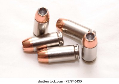 A group of hollow point 40 caliber bullets on a white background