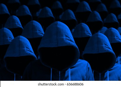 Group of hooded hackers with side light in blue cybersecurity concept