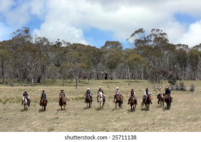 A group of horseriders in the Australian outback