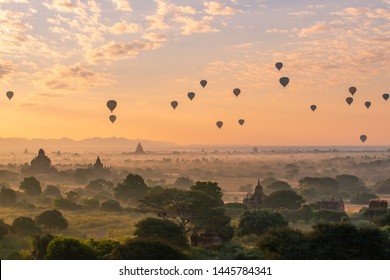 Group of the hot air balloons flying over ancient pagoda in Bagan plain at dawn. Bagan now is the UNESCO world heritage site and the first kingdom of Myanmar.