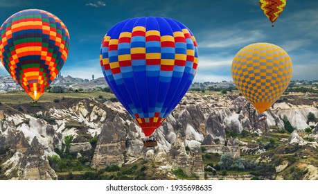 Group of Hot air balloons landing in mountains with sunlight rock kjerag landscape Travel concept.