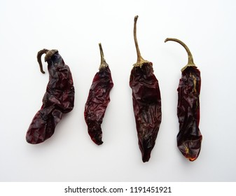 Group Hot Chipotle chilies (dried jalapeño), isolated on a white background