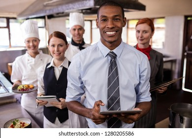Group of hotel staffs working in kitchen at hotel