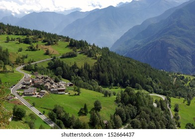 group of houses along a road in a slope of the Valle d'Aosta