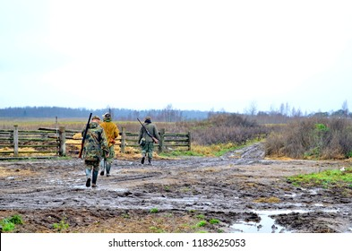 Group of hunters during hunting in forest. chase hunting. Hunter with weapon. Hunter with friends. Hunters walking in the forest. hunters on hunting in the fall. hunter at dawn