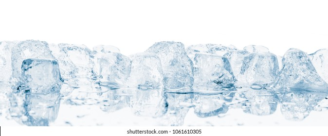 Group of ice cubes on mirroring reflective surface.