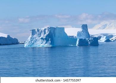A group of icebergs among the islands around the Antarctic Peninsula, Antarctica