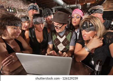 Group of impressed biker gang members watching nerd using a computer