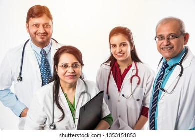 Group of Indian medical doctors, male and female standing isolated on white background, selective focus