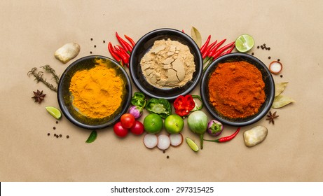 Group of indian spices and herbs difference ware on brown background with top view and copy space for design foods, vegetable, spices, herbs, healthy lifestyle or other your content.