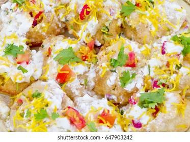 Group of Indian Sweet And Spicy Chaat item Dahi Puri Also Called Dahi Batata Puri, Golgappe, Dahi Bhalle, Gol Gappa or Dahipuri Stuffed With Boiled Potato, Yogurt, Sev, Coriander, Chutney