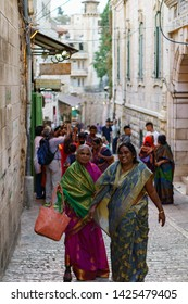 A group of indians walking in the streets  ( Via Dolorosa ) of jerusalem for being a pilgrim in jerusalem in israel palestine 21 october 2019