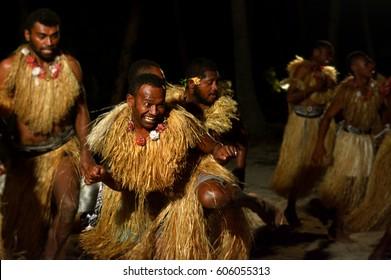 Group of Indigenous Fijian men dancing a traditional male dance meke wesi the spear dance. Real people. Copy space