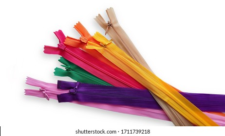 Group of isolated colorful zippers on white background. Pink, purple, yellow, orange, green, beige zippers.