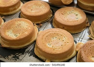 The group of Japanese red bean cake dessert on hole bean cake maker at food street market.