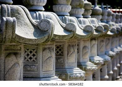 Group of Japanese Stone Lanterns in an ornamental garden