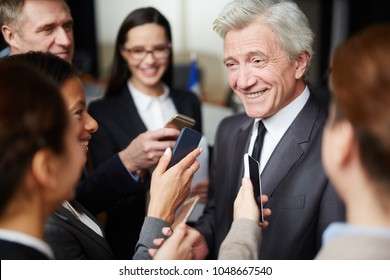Group of journalists recording speech of famous politician during press conference