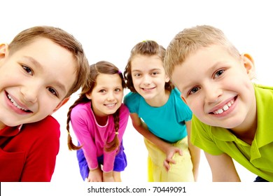 Group of joyful children peeping into camera