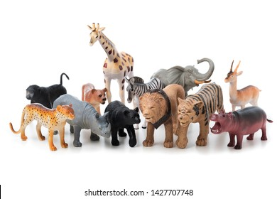 Group of jungle animals toys isolated over white background. Plastic animals toys.