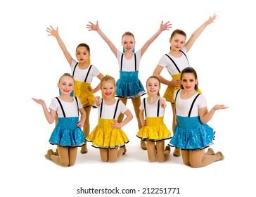 A group of junior jazz dancers in recital costume