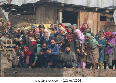A group of Kashmiri Muslim female mourners weeping while taking a last glimpse of the slain Lashker outfit rebel, Basit Ahmad Mir, at his native village Khanabal in Anantnag, on 23 November 2018.