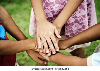 Group of kid people stacking their hands