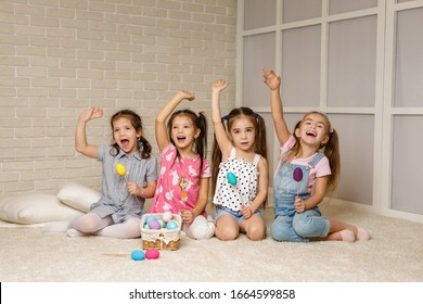 Group of kid sitting on floor together. four little girls have fun . friendship concept