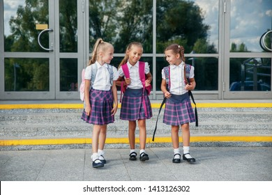 Group of kids with backpack going to school together