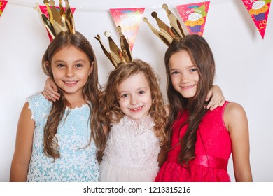 Group of kids celebrate birthday party together. Holidays concept.
