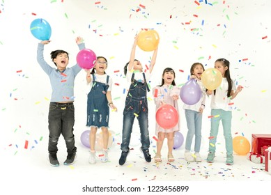 Group of kids celebrate christmas and happy new year party together.