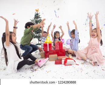 group of kids celebrate party and enjoy christmas fun together