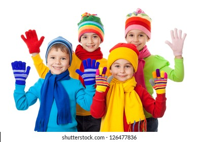 Group of kids in colorful winter clothes, isolated on white